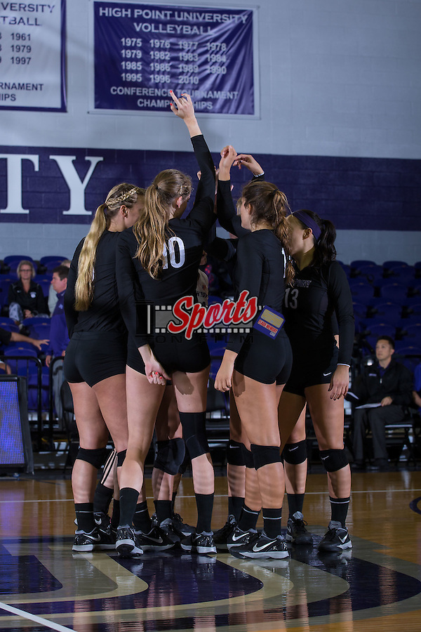 The High Point Panthers huddle up prior to the start of their match against the Marshall Thundering Herd at the Panther Invitational at the Millis Athletic Center on September 12, 2015 in High Point, North Carolina.  The Thundering Herd defeated the Panthers 3-2.   (Brian Westerholt/Sports On Film)