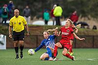 Allston, MA - Sunday, May 1, 2016:  Referee Brandon Artis, Boston Breakers defender Rachel Wood (24) and Portland Thorns FC midfielder Dagny Brynjarsdottir (11) in a match at Jordan Field, Harvard University.