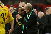 Pep Guardiola and Raheem Sterling of Manchester City after the trophy lift.   Aston Villa vs Manchester City, Caraboa Cup Final Football at Wembley Stadium on 1st March 2020
