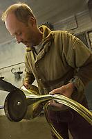 Europe/France/Centre/41/Loir-et-Cher/Sologne/Blois:  Fabrication d'une trompe de Chasse à l' Atelier Les Trompes de Milliens, fabricant de trompes de chasse . Métal rougi pour rendre malléable le pavillon avant le martelage - Auto N°: 2012-4106  //  France, Loir et Cher, Sologne/ Blois: Manufacture of hunting horn - Atelier Les Trompes de Milliens,