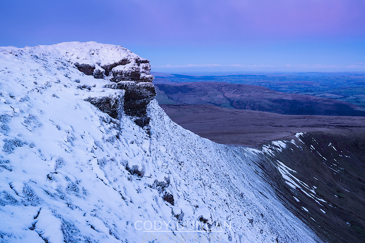 Snow covered summit of Corn Du at dawn, Brecon Beacons national park, Wales