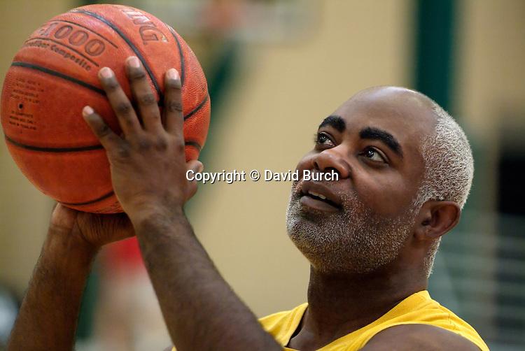 African American man shooting basketball