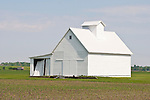 White wooden barn, newly planted field, rural Ill.