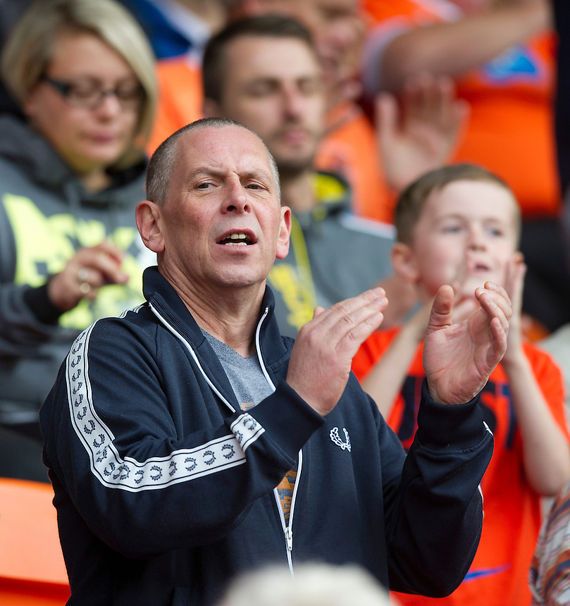 Blackpool fans cheer their team as they claim their first loint of the season<br /> <br /> Photographer Stephen White/CameraSport<br /> <br /> Football - The Football League Sky Bet Championship - Blackpool v Wolverhampton Wanderers - Saturday 13th September 2014 - Bloomfield Road - Blackpool<br /> <br /> &copy; CameraSport - 43 Linden Ave. Countesthorpe. Leicester. England. LE8 5PG - Tel: +44 (0) 116 277 4147 - admin@camerasport.com - www.camerasport.com