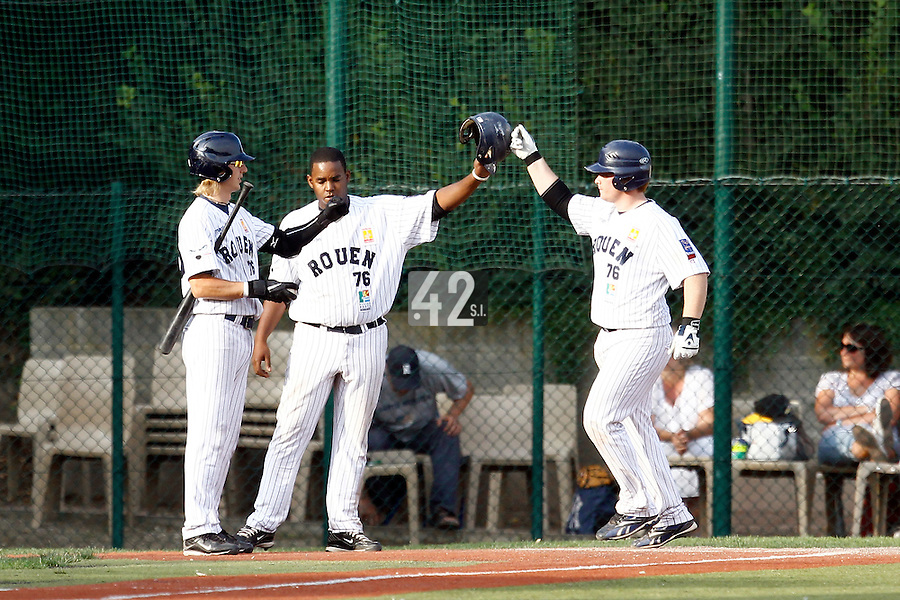 15 July 2011: Catcher David Gauthier of the Rouen Huskies is congratulated by his teammates following his home run during the 2011 Challenge de France match won 6-5 by the Rouen Huskies over the Senart Templiers at Stade Pierre Rolland, in Rouen, France.