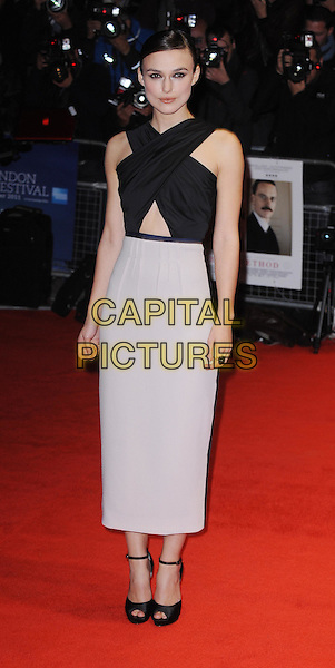 Keira Knightley (wearing Roksanda Ilincic).'A Dangerous Method' premiere, 55th BFI London Film Festival, Odeon West End cinema, Leicester Square, London, England..24th October 2011.full length dress black criss-cross bodice keyhole detail midriff grey gray ankle peep toe strap sandals.CAP/WIZ.© Wizard/Capital Pictures.
