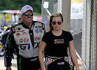 May 11, 2013; Commerce, GA, USA: NHRA funny car driver John Force (left) walks with his daughter top fuel dragster driver Brittany Force during the Southern Nationals at Atlanta Dragway. Mandatory Credit: Mark J. Rebilas-