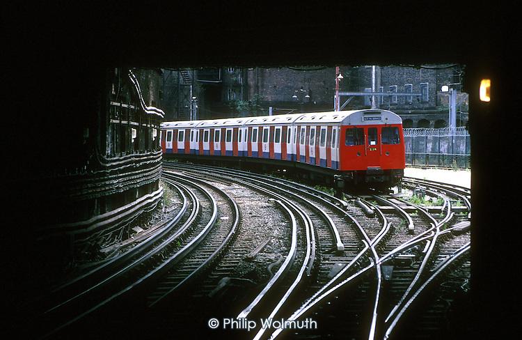 Tube train approaches Farringdon underground station, London