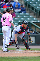 Columbus Clippers catcher Omir Santos #11 retrieves a blocked ball as Chris Herrmann #18 looks on during a game against the Rochester Red Wings on May 12, 2013 at Frontier Field in Rochester, New York.  Rochester defeated Columbus 5-4.  (Mike Janes/Four Seam Images)