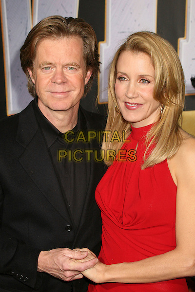 "WILLIAM H. MACY & FELICITY HUFFMAN.""Wild Hogs"" Los Angeles Premiere at the El Capitan Theatre, Hollywood, California, USA..February 27th, 2007.half length red dress black suit husband wife married holding hands .CAP/ADM/BP.©Byron Purvis/AdMedia/Capital Pictures"