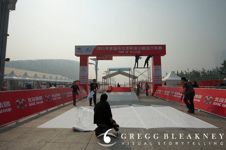 Race officials prep the starting line of the 2011 Tour of Beijing, Stage 1 ITT