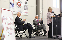 NWA Democrat-Gazette/DAVID GOTTSCHALK  Governor Asa Hutchinson (from left) and U.S Congressmen Steve Womack applaud  as  Terrie Metz, superintendent, speaks Tuesday, August 8, 2017, inside the Diesel Lab Tuesday, August 8, 2017 at the new Gentry Career and Technical Education Center on the high school campus. Guests, dignitaries and school personnel attended opening ceremonies at the center designed for the Bentonville, Decatur, Gentry and the Gravette School districts. The center will concentrate on diesel technology and medical field professions.
