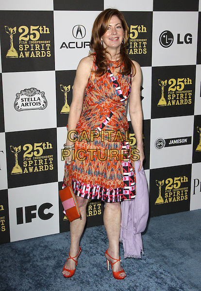 DANA DELANY .25th Annual Film Independent Spirit Awards held At The Nokia LA Live, Los Angeles, California, USA,.March 5th, 2010 ..arrivals Indie Spirit full length orange print patterned pattern dress printed red open toe shoes clutch bag sleeveless green pink .CAP/ADM/KB.©Kevan Brooks/Admedia/Capital Pictures