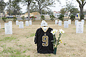 Saints fan at grave site