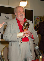 """Spanish actor FRANCISCO RABAL(R) pose for photographer after beeing presented a Special Grand Prize of the Americas by the World Film Festival'sVice President Daniele Cauchard (L) ,<br /> August 25th, 20001 in Montreal , Canada.<br /> <br /> <br /> Born in ¡guilas, Spain in 1925, Francisco Rabal . <br /> In 1950 he won his first real stage roles. Luis BuÒuel saw him in Historias de la radio and decided to cast him in the lead role of his new film to be shot in Mexico, NAZARÕN. This marked the beginning not only of Rabal's international career but also his lifelong friendship and collaboration with BuÒuel - including such masterpieces as VIRIDIANA (1961) and BELLE DU JOUR (1967).<br /> As a result of his performances in BuÒuel's early films, Rabal was sought after by many of the era's top international directors - Antonioni (THE ECLIPSE), Rivette (THE NUN), Visconti (THE WITCHES) - as well as directors of the so-called """"new Spanish cinema"""", in particular Carlos Saura, Miguel Picazo, Antonio Bardem and Jorge Grau. He made his American feature debut in 1977 in William Friedkin's SORCERER and won best actor awards at several festivals, including Cannes 1984 for his role in Mario Camus's THE HOLY INNOCENTS (!984) and the Montreal World Film Festival for his performance in Alain Tanner's THE MAN WHO LOST HIS SHADOW (1991).<br /> Rabal remained very active through the 1980s and 1990s, appearing in films by Pedro AlmÛdvar, Saura, Eliseo Subiela and Arturo Ripstein. In 1999 he played the title role in Saura's GOYA IN BORDEAUX shown at the 1999 Montreal Festival, a performance which won international critical acclaim.<br /> Rabal's cinematic heritage continues in the persons of his actress-daughter Teresa Rabal, director-son Benito Rabal and actor-grandson Liberto Rabal.<br /> <br /> Photo by Pierre Roussel / Getty Images News Service (ON SPEC)<br /> <br /> <br /> NOTE : Nikon D-1 JPEG opened with QUIMAGE ICC profile , saved as Adobe RG 1998 color space."""