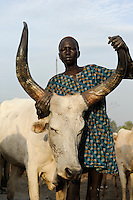 SOUTH SUDAN Bahr al Ghazal region , Lakes State, cattle camp near Rumbek, Dinka children live and work with Zebu cow / SUED-SUDAN  Bahr el Ghazal region , Lakes State, Dinka Kinder leben und arbeiten mit Zebu Rindern im cattle camp bei Rumbek