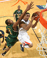 Dec. 20, 2010; Charlottesville, VA, USA; Virginia Cavaliers guard Jontel Evans (1) floats in front of the basket with Norfolk State Spartans guard/forward Rob Hampton (1) during the game at the John Paul Jones Arena. Virginia won 50-49. Mandatory Credit: Andrew Shurtleff