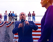 United States Senator John McCain (Republican of Arizona) campaigns outside his presidential campaign headquarters in Alexandria, Virginia on February 27, 2000.  His wife Cindy can be seen at right..Credit: Ron Sachs / CNP