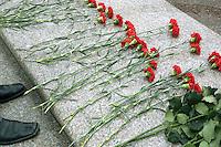 Azerbaijan. Baku region. Baku. Black leather shoes and chrysanthemum flowers on the marble grave of Heidar Aliev. The deceased political leader Heydar Aliyev ( May 10, 1923 - December 12, 2003), also spelled as Heidar Aliev, Geidar Aliev, Haydar Aliyev, is buried in the cemetery.  Heydar Aliyev was the president of Azerbaijan for the New Azerbaijan Party from June 1993 to October 2003.  © 2007 Didier Ruef