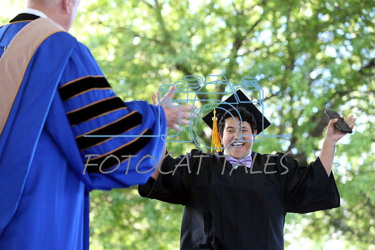 Isabel Meza, of Gardnerville, celebrates as she receives her diploma at the Western Nevada College 2017 Commencement in Carson City, Nev. on Monday, May 22, 2017.  <br />Photo by Cathleen Allison/Nevada Photo Source