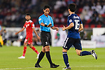 FIFA Referee Mohd Amirul Izwan of Malaysia (L) speaks to Tomiyasu Takehiro of Japan (R) during the AFC Asian Cup UAE 2019 Group F match between Oman (OMA) and Japan (JPN) at Zayed Sports City Stadium on 13 January 2019 in Abu Dhabi, United Arab Emirates. Photo by Marcio Rodrigo Machado / Power Sport Images