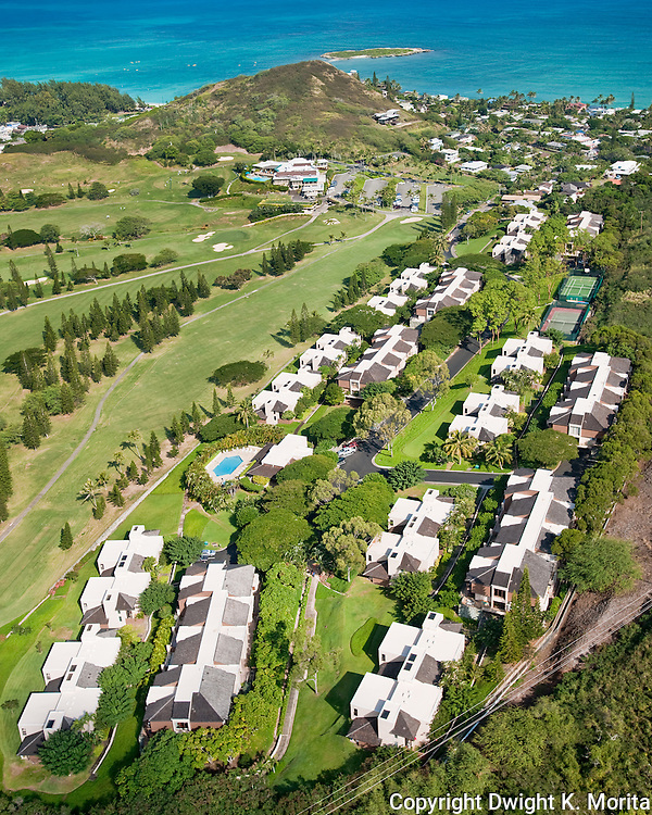 Bluestone Condominiums - Kaelepulu street condos overlook the 18th fairway leading to the clubhouse at the Mid-Pacific Country Club. Bluestone Community Center and pool visible in the foreground and the tennis courts in the upper right.