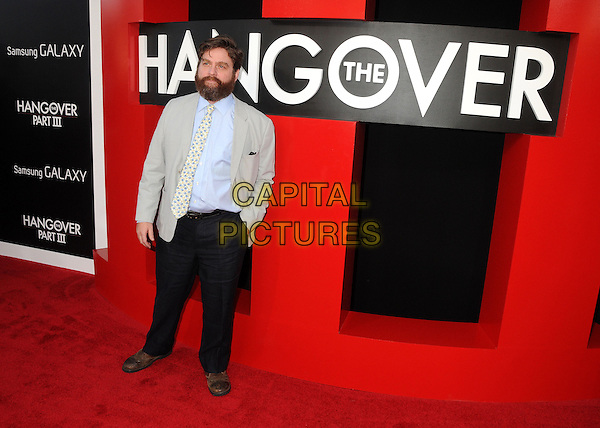 "Zach Galifianakis.""The Hangover Part III"" Los Angeles Premiere held at the Westwood Village Theater, Los Angeles, California, USA..May 20th, 2013.full length trousers beard facial hair blue yellow tie floral print shirt grey gray.CAP/ADM/BP.©Byron Purvis/AdMedia/Capital Pictures"