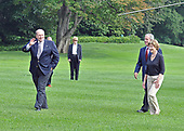 Washington, D.C. - July 20, 2008 -- United States President George W. Bush and first lady Laura Bush follow behind outgoing Deputy White House Chief of Staff Joe Hagin as they arrive on the South Lawn of the White House after a week-end trip to the west coast and his ranch at Crawford, Texas.<br /> Credit: Ron Sachs / Pool via CNP