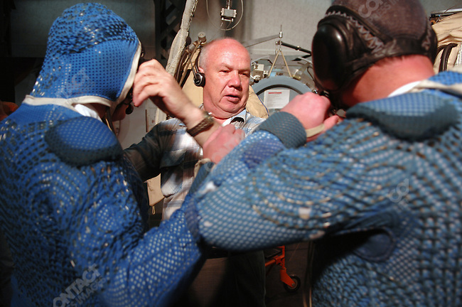 At one of the training centres at Star City, the Russian space training centre outside of Moscow, cosmonaut Yuri Lonchakov, commander of Soyuz 18, and astronaut Mike Fincke, ISS commander, adjusted their water cooled under-suits with an engineer before going through a training programme in the Orlan-MK space suits simulating work on the Russian Segment Airlock on the International Space Station. Star City, Russia, June 24, 2008.
