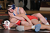 John Arceri of Huntington, top, battles James Trezza of Smithtown East at 113 pounds during the Suffolk County varsity wrestling Division I semifinals at Hofstra University on Sunday, February 15, 2015. Arceri won the match by decision.<br /> <br /> James Escher