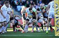 Danny Care of Harlequins is stopped short of the line by former team mate Tom Guest of London Irish during the Aviva Premiership Rugby match between Harlequins and London Irish at The Twickenham Stoop on Saturday 7th March 2015 (Photo by Rob Munro)
