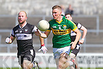 Denis Daly of Kerry races past Barry O'Mahony of Sligo in the GAA Football All-Ireland Junior Championship Semi Final last Saturday in Cusack Park, Ennis.