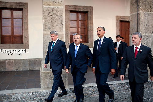 President Barack Obama, Canada's Prime Minister Stephen Harper, left, Mexico's President Felipe Calderon, second from left, and  governor Emilio Gonzalez, right, walk across the main courtyard at the the Cabanas Cultural Center during the North American Leaders' Summit in Guadalajara, Mexico, August 10, 2009.  (Official White House Photo by Pete Souza)<br /> <br /> This official White House photograph is being made available only for publication by news organizations and/or for personal use printing by the subject(s) of the photograph. The photograph may not be manipulated in any way and may not be used in commercial or political materials, advertisements, emails, products, promotions that in any way suggests approval or endorsement of the President, the First Family, or the White House.