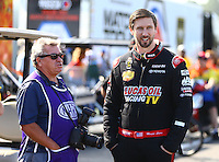 Mar 20, 2016; Gainesville, FL, USA; NHRA top fuel driver Morgan Lucas (right) with photographer Richard Shute during the Gatornationals at Auto Plus Raceway at Gainesville. Mandatory Credit: Mark J. Rebilas-USA TODAY Sports