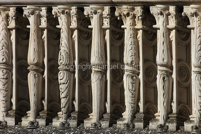 Decorative sculpted balustrades on the monumental spiral staircase, 16th century, French School, on the interior South East facade of the Francois I wing, in Renaissance style, at the Chateau Royal de Blois, built 13th - 17th century in Blois in the Loire Valley, Loir-et-Cher, Centre, France. The staircase is covered in bas-relief sculptures and looks onto the courtyard of the chateau. The chateau has 564 rooms and 75 staircases and is listed as a historic monument and UNESCO World Heritage Site. Picture by Manuel Cohen