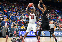 NWA Democrat-Gazette/CHARLIE KAIJO Arkansas Razorbacks forward Darious Hall (20) reaches for a shot as South Carolina Gamecocks forward Chris Silva (30) covers during the Southeastern Conference Men's Basketball Tournament, Thursday, March 8, 2018 at Scottrade Center in St. Louis, Mo.