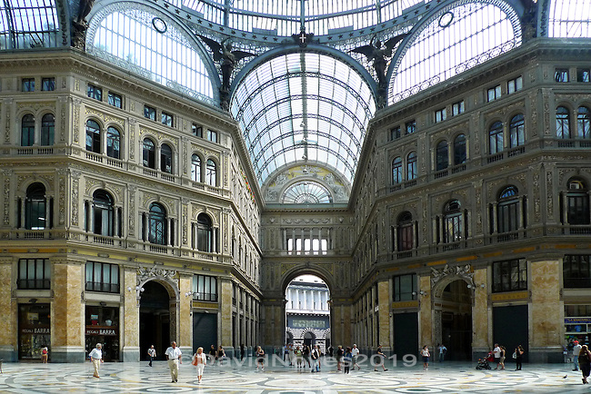 Built between 1887, the Galleria Umberto I was named for Umberto I, King of Italy at the time of construction. From the beginning, it combined businesses, shops, cafes and apartments in a unique public space under a magnificent glass roof. The galleria sustained significant damage and was re-built following WWII.