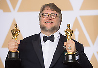 Guillermo del Toro poses backstage with the Oscar&reg; for best motion picture and best director for work on &ldquo;The Shape of Water&rdquo; during the live ABC Telecast of The 90th Oscars&reg; at the Dolby&reg; Theatre in Hollywood, CA on Sunday, March 4, 2018.<br /> *Editorial Use Only*<br /> CAP/PLF/AMPAS<br /> Supplied by Capital Pictures