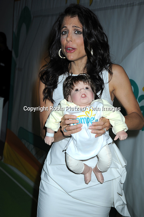 "Bethenny Frankel and a doll attending the kick-off of Father's Day week with  The Pampers with Dry Max Pays Homage to ""Dads on Diaper Duty""  event on June 17, 2010 at The Metropolitan Pavilion in New York City."