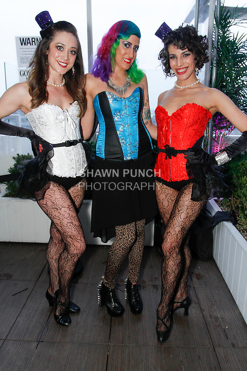 Guest (center) poses with dancers from Atomic Entertainment, duirng the inaugural National Corset Day press party hosted by Adore Me, at the Sky Room in New York City, May 20, 2014.