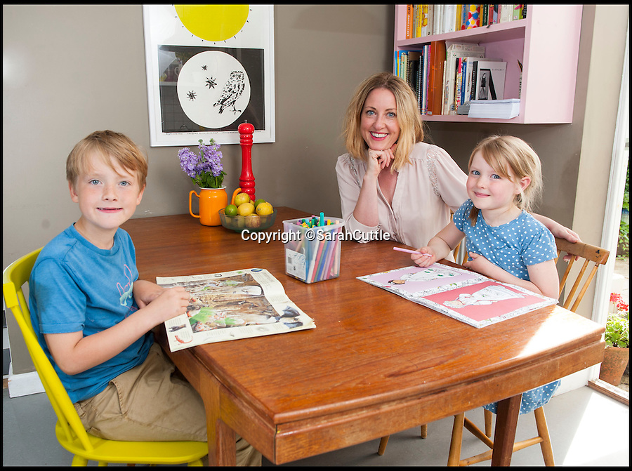 BNPS.co.uk (01202 558833)<br /> Pic: SarahCuttle/BNPS<br /> <br /> Transformed - Sarah Thompson's own former council house in Bridport, Dorset, with kids Stanley(8) and Betty(6).<br /> <br /> Don't judge a book by its cover - New book reveals the trendy and chic interiors hidden behind some of Britains drab former council houses.<br /> <br /> Swathes of Britain's humble council houses are being transformed from drab homes into designer pads by a generation of buyers desperate to get on the housing ladder, a new book has revealed.<br /> <br /> Local authorities built the grey, uninspiring homes in their thousands in the 1950s as the country embraced the post-war social housing boom before selling them off under Margaret Thatcher's controversial 'right to buy' act of 1980.<br /> <br /> Now, six decades on, they might still not look like much from the outside but council houses are enjoying a surprise new lease of life as the home of choice for first time buyers.<br /> <br /> The shift in attitudes towards the humble council house have been chronicled by former journalist Sarah Thompson in her new book Style Council: Inspirational Interiors in Ex-Council Homes.