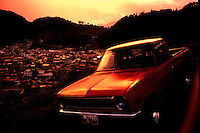Red truck over Xela, Guatemala.