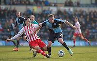Lee Cox of Stevenage tackles Garry Thompson of Wycombe Wanderers during the Sky Bet League 2 match between Wycombe Wanderers and Stevenage at Adams Park, High Wycombe, England on 12 March 2016. Photo by Andy Rowland/PRiME Media Images.