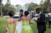 ADDIS ABABA, ETHIOPIA - NOVEMBER 13: A bride and her bridesmaids prepare to poses for a wedding photographer in a park at Ghion Hotel on November 13, 2010 in Addis Ababa, Ethiopia. The weekends are full of Western style weddings, most popular are to have a Lincoln Town car limos and Mercedes Limos. Some people can afford to put these weddings through in this one of Africa's poorest countries. (Photo by Per-Anders Pettersson)