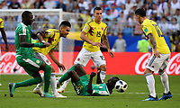 SAMARA - RUSIA, 28-06-2018: Cheikhou KOUYATE (Izq) y Sadio MANE (Der) jugador de Senegal disputa el balón con Radamel FALCAO GARCIA (C) jugador de Colombia durante partido de la primera fase, Grupo H, por la Copa Mundial de la FIFA Rusia 2018 jugado en el estadio Samara Arena en Samara, Rusia. / Cheikhou KOUYATE (L) and Sadio MANE (R) player of Senegal fights the ball with Radamel FALCAO GARCIA (C) player of Colombia during match of the first phase, Group H, for the FIFA World Cup Russia 2018 played at Samara Arena stadium in Samara, Russia. Photo: VizzorImage / Julian Medina / Cont