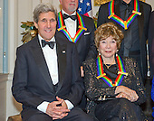 United States Secretary of State John F. Kerry and Shirley MacLaine pose for a group photo with the other four recipients of the 2013 Kennedy Center Honors  following a dinner hosted by Kerry at the U.S. Department of State in Washington, D.C. on Saturday, December 1, 2013.  The 2013 honorees are opera singer Martina Arroyo; pianist, keyboardist, bandleader and composer Herbie Hancock; pianist, singer and songwriter Billy Joel; actress Shirley MacLaine; and musician and songwriter Carlos Santana.<br /> Credit: Ron Sachs / CNP