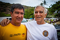 "HONOLULU, Oahu, Waimea Bay - Thursday, November 28, 2012 Former winner Keone Downing (HAW) with his farther, contest director George Downing (HAW). -- The 28th annual Quiksilver In Memory of Eddie Aikau official opening ceremony and blessing today at Waimea Bay on the North Shore of Oahu. The ceremony  featured this year's 28 Invitees, including newly elected riders John John Florence (Hawaii), Ian Walsh (Maui), and Alex Gray (California), as well as former ""Eddie"" champions Kelly Slater (Florida), Greg Long (California), and Ross Clarke-Jones (Australia). The surfers will be joined by members of the Aikau family, including Eddie's younger brother and Invitee Clyde Aikau...When the Invitees and Alternates paddled out and grouped in the traditional surfer's circle it's about camaraderie and making a connection to the others who will ultimately share in your experience and watch out for your safety..The holding period for the Quiksilver In Memory of Eddie Aikau will commence on Saturday, December 1, and runs through  to February 28, 2013. The event requires one day of quality waves in the giant range of 20 feet or more. Waves of this size are only generated occasionally by hurricane force winds from intense storms in the Pacific NW. The elements of wind, swell height and arrival time to the island's shore must be in perfect alignment to allow a full eight hours of daytime competition..Waimea Bay was Eddie Aikau's home away from home. It was here that he saved countless lives as the Bay's first official lifeguard, and successfully rode the largest waves of his day. An early pioneer of big wave riding in Hawaii, Eddie has inspired generations of ""storm surfers"" who today roam the globe year-round in search of giant waves..The Quiksilver In Memory of Eddie Aikau has only been held a total of eight (8) times, most recently on December 8, 2009. California's Greg Long (California) took the honor that year. .Photo: joliphotos.com"