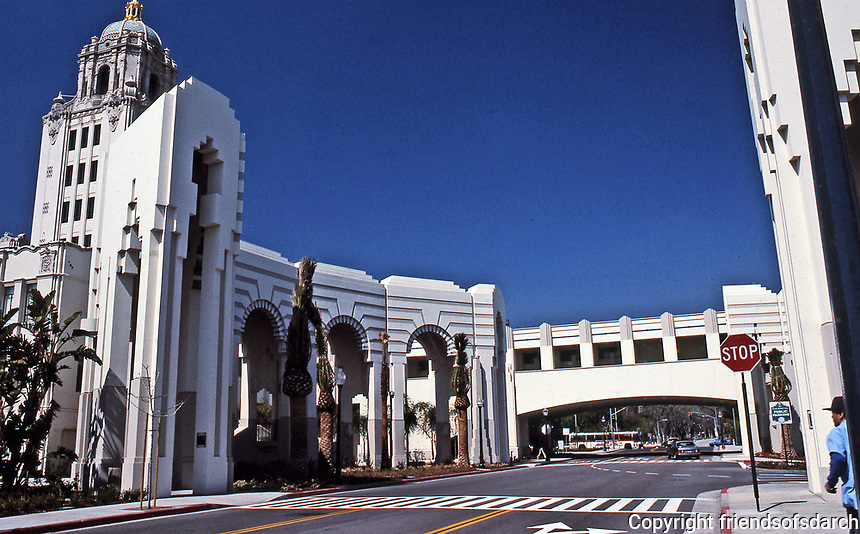 Beverly Hills Civic Center, designed by Charles Moore, is a mixture of Spanish Revival, Art Deco and Post-Modern styles. It features courtyards, colonnades, promenades, and buildings, with both open and semi-enclosed spaces, stairways and balconies. Completed in 1990. Photo July 1991.