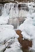 Champney Falls during the winter months in Albany, New Hampshire USA. This waterfall is located along Champney Falls Trail.