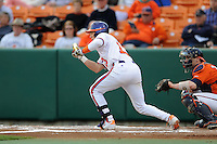 Clemson Tigers  third baseman Jay Baum #13 squares to bunt during a game against the Virginia Cavaliers  at Doug Kingsmore Stadium on March 15, 2013 in Clemson, South Carolina. The Cavaliers won 6-5.(Tony Farlow/Four Seam Images).